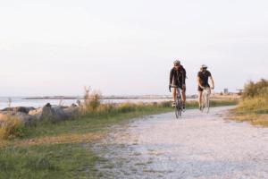 gravel bike riders near a river
