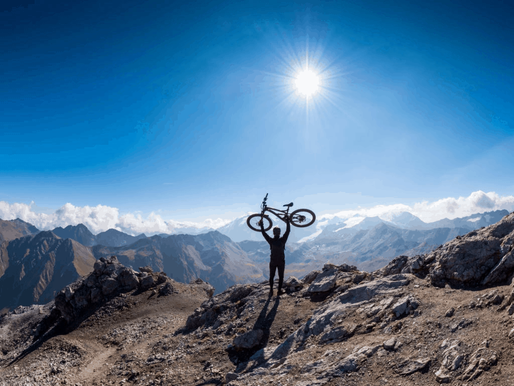 man carrying a mountain bike