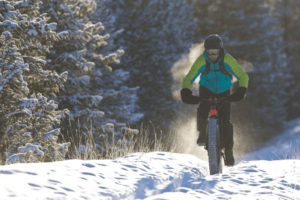 man goes for a fatbike ride on cold winter