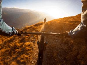Personal perspective shot of a man riding schwinn mountain bike