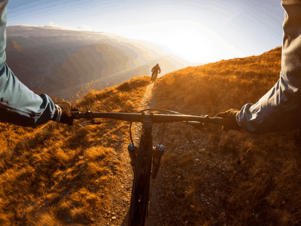 Personal perspective shot of a man riding schwinn mountain bike